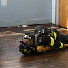 The goal: to rescue this 210 pound dummy fire fighter who ran out of air and collapsed in a building filled with smoke.