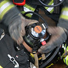 Securing the mask on the unconscious fire fighter.