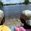 Toni Sholola, 12 on right, and sister Tope 10, fished during the Lynn Mass Bass club's annual youth fishing derby at Flax Pond in Lynn Sunday May 16, 2010. Item Photo/ Reba M. Saldanha