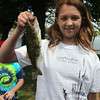 Kelsey McDuff, 11, shows off her catch during the Lynn Mass Bass club's annual youth fishing derby at Flax Pond in Lynn Sunday May 16, 2010. Item Photo/ Reba M. Saldanha