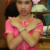 Kayla Chau, of the Apsara Dance Troop performs a dance for the flower at Cambodian Community Day at Lynn City Hall on Saturday.