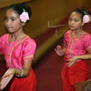 Kayla Chau and Nicole Heldt of the Apsara Dance Troop exiting the stage in the city council chambers after performing za dance fro the flower on Cambodian Community Day.