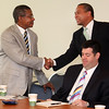 Governor Deval Patrick shook hands with everyone at the table at the Lynn Business Partnership meeting held at the Eastern Bank headquarters on Market Street this morning including Don Edwards, the Executive Director of Operation Boot Strap.