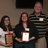 Award winners at the sixth annual Communities That Care luncheon. From left to right are: Tosha Duester, Gaylynne Samsonoff and Bob Connolly of Serving People in Need Inc. doing the presenting.