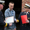 Dylan Badger, 16, is credited with saving the Kidney family of Lynn after putting out a fire on their back porch recently. He received a citation from Lynn Fire Chief Dennis Carmody, right, and Deputy Chief James McDonald at the Lynnfield St headquarters Item Photo/ Reba M. Saldanha