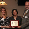 Catherine Dhingra, of Girl's Inc. in Lynn, presents Tara Cleary, Adv. & New Media Sales Director at the Lynn Item and Phil Ouelette, General Manager at the Lynn Item with awards at the sixth annual Communities That Care award and luncheon today.