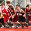 Dan Kong, 846, Alex Funez, 919, and Perry Raymond, 852, at the start of the boy's two mile.