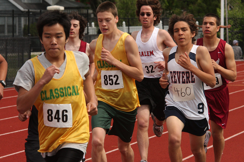 Dan Kong, 846, and Perry Raymond, 852 in the boy's two mile at the Northeastern Conference track meet held at Manning Filed on Saturday.