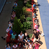 Nicole Miserandiono's first grade class at the Hood School in Lynn re-did the court yard at the school. What they are sitting on is the biggest section of the courtyard. They repainted it and replanted it.