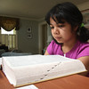 Amber Born studying with a dictionary at home in Marblehead today.