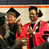 Dr Elizabeth Williams, right, and Professor Jane Levesque cheer for graduates during North Shore Community College's graduation exercises at Salem State College Thursday May 27, 2010. Item Photo/ Reba M. Saldanha