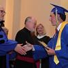 Head of School Raymond Bastarache congratulates salutatorian Kevin McCarthy during St Mary's 128th commencement at St Mary's church Thursday May 27, 2010. Item Photo/ Reba M. Saldanha