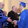 Head of School Raymond Bastarache congratulates valedictorian Anthony Cardillo during St Mary's 128th commencement at St Mary's church Thursday May 27, 2010. Item Photo/ Reba M. Saldanha