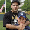 Joseph Rosario and father Leonardo pose for a photo during the Challenger Little League opening day festivities at Volunteer Field in Lynn Sunday May 2, 2010. Item Photo/ Reba M. Saldanha