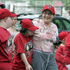 Betty Ross with daughter Ilyse, center, and Amanda Tower walk in the Challenger Little League opening day parade to Volunteer Field in Lynn Sunday May 2, 2010. Item Photo/ Reba M. Saldanha