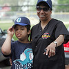 Rhonda Greene and son Corey walk in the Challenger Little League opening day parade to Volunteer Field in Lynn Sunday May 2, 2010. Item Photo/ Reba M. Saldanha