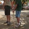 A big part of Peter's Eagle Scout project was leadership. He coordinated others to help in the project. Here he gives Billy Kraemer some pointers on sweeping.