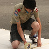 Part of Peter Louvaris's Eagle Scout project included painting a map of the United States in the playground. Here he tapes down the stencil he'll use for the painting.