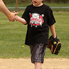 Logan rose comes in from catching fly balls at the home run derby at Parcher Field in Saugus on Saturday.
