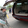 National Guardsman Ashley Soulard loads water into a car at Nahant Fire Department where the National Guard provided water for town residents Sunday May 2, 2010. Item Photo/ Reba M. Saldanha