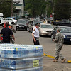 (from left) Nahant fireman Patrick Carritte, Naional Guardsman Ashley Soulard, Lt Tom Hutton of Nahant PD, and Naional Guardsman Sgt. Michael Palmer distribute water to cars at Nahant Fire Department where the National Guard provided water for town residents Sunday May 2, 2010. Item Photo/ Reba M. Saldanha