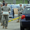National Guardsmen Sgt. Michael Palmer and Ashley Soulard load water into a car at Nahant Fire Department where the National Guard provided water for town residents Sunday May 2, 2010. Item Photo/ Reba M. Saldanha