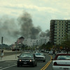 Smoke from the fire in the field next to Wonderland makes its way to Revere Beach Blvd and out to sea.