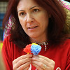 Cinco de Mayo festivities at the Boy's and Girl's Club in Lynn. Paula Femino, of the Target store in Revere, builds paper flowers.