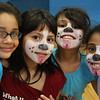 Cinco de Mayo festivities at the Boy's and Girl's club in Lynn. Puppies. From left to right: Kimberly Gomez, Kate Arriaga, Linda Arrecchia, and Jianna Hernandez.