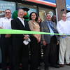 Cumberland Farms opened a new store at 668 Chestnut Street in Lynn today. there for the ribbon cutting from left to right are: Frank Koughan, CEO Lynn Ladder, Captain Bob Burke, Lynn Fire, Bob Jenness, Regional Manager Cumberland Farms, Barbara Eckoff, Store Manager, Gwen Forman, Vice President of marketing , Thomas Strangie, Vice Principal  Lynn English High, Grady Jean Francois, Aid to the Mayor, and Ken Flint, Area Manager.