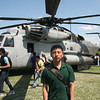 Windman Mendez, a student at Lynn English, with a CH-53E Super Stallion Marine Helicopter that visited Lynn English High today.