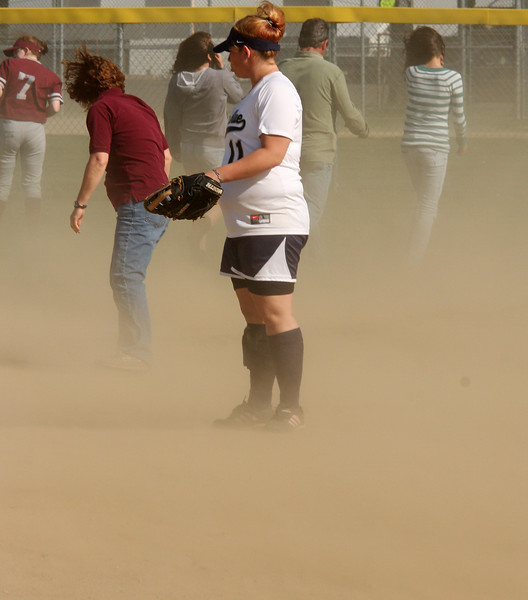 Wind conditions kicked up the dust during the game.