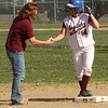 Samantha Earp is congratulated at third base.