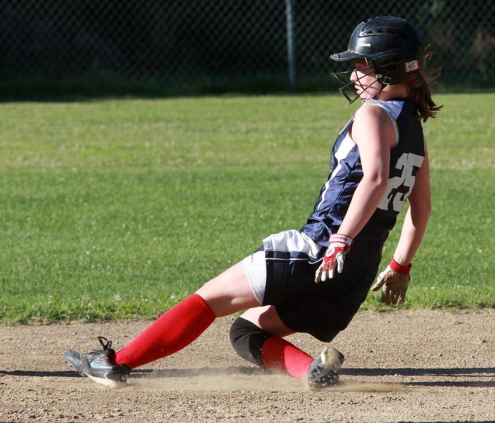 Emma Faulkner sliding into second base.