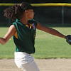 Shannon Magner throws to first