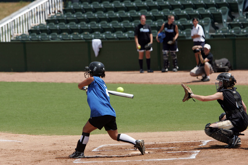 Catcher Abby Blecher and Kristina Burri at the Agganis softball classic Sunday July 11, 2010. Item Photo/ Reba M. Saldanha