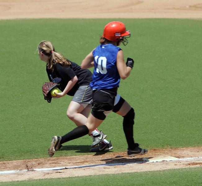 Silvie Cohen, left, and Kiki McKenna at the Agganis softball classic Sunday July 11, 2010. Item Photo/ Reba M. Saldanha