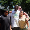 From left, Andre Robinson Jr and Sr, Johnny Fleury, and Amy RObinson at the Williams Ave playground clean up Saturday July 10, 2010. Item Photo/ Reba M. Saldanha
