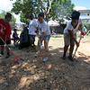 Volunteers spread mulch at the Williams Ave playground clean up Saturday July 10, 2010. Item Photo/ Reba M. Saldanha