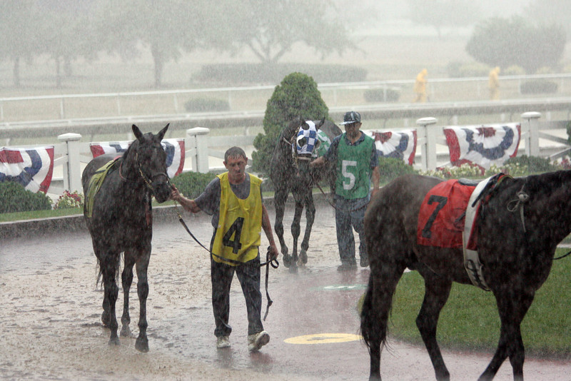 Wet horses at Suffolk Downs 75 Anniversary Party Saturday July 10, 2010. Item Photo/ Reba M. Saldanha