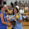 Julie Halloran with MVP Amy Fahey of Wilmington during the Agganis women's basketball classic at LEHS MOnday July 12, 2010. Item Photo/ Reba M. Saldanha