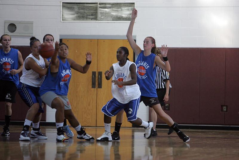 Jenicia Duggins passes during the Agganis women's basketball classic at LEHS MOnday July 12, 2010. Item Photo/ Reba M. Saldanha