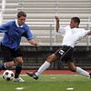 Cristian Lopez, right, Colin Smith during the Agganis men's soccer classic at Manning Field Tuesday July 13, 2010. Item Photo/ Reba M. Saldanha