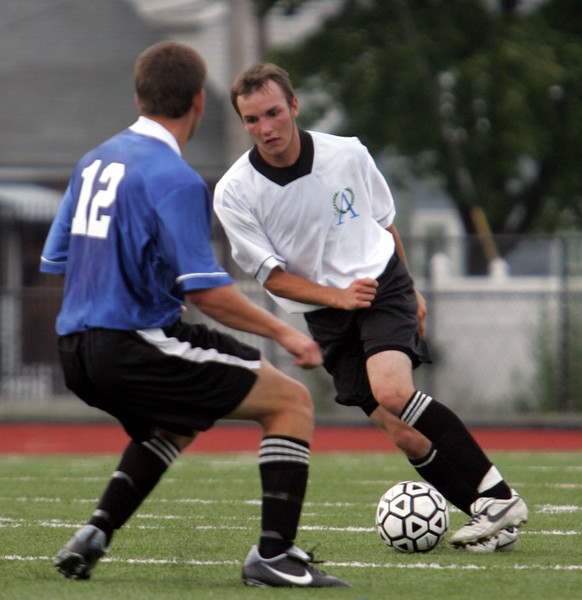 Caleb Rogers, left, and Alex Glover during the Agganis men's soccer classic at Manning Field Tuesday July 13, 2010. Item Photo/ Reba M. Saldanha