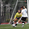 Lauren DOnati sneaks the ball past North side goal keeper during the Agganis women's soccer classic at Manning Field Tuesday July 13, 2010. Item Photo/ Reba M. Saldanha