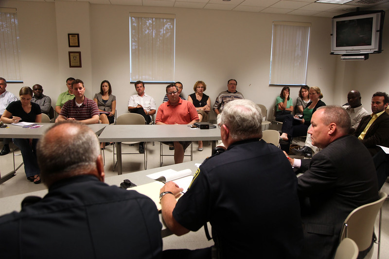 A meeting between concerned citizens and area officials at Lynn Police headquarters Tuesday July 13, 2010. Also pictured are John Hogan, left, and Officer William Bice of the transit police. Item Photo/ Reba M. Saldanha