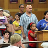 Shelley Stamoulis and her 9 year old daughter Aaliya Bencosme head a line of people against the proposed pitbull ordinance at a City Hall public hearing Tuesday July 13, 2010. Item Photo/ Reba M. Saldanha