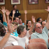 Attendees raise their hands in favor of the proposed pitbull ordinance at a City Hall public hearing Tuesday July 13, 2010. Item Photo/ Reba M. Saldanha