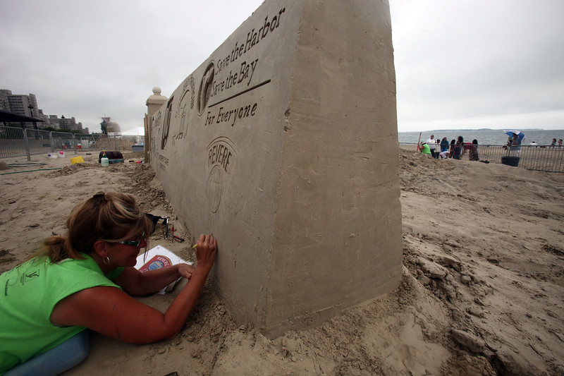 Debby Barrett Cutulle on the first day of sculpting at Revere Beach Wednesday July 14, 2010. Item Photo/ Reba M. Saldanha