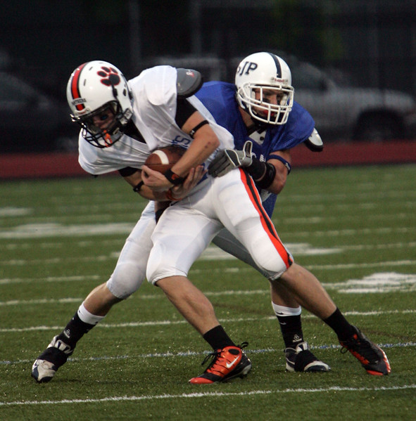 Justin Mars of Beverly and Michael Uva of St John's at the Agganis All Star football classic at Manning Field Thursday July 15, 2010. Item Photo/ Reba M. Saldanha